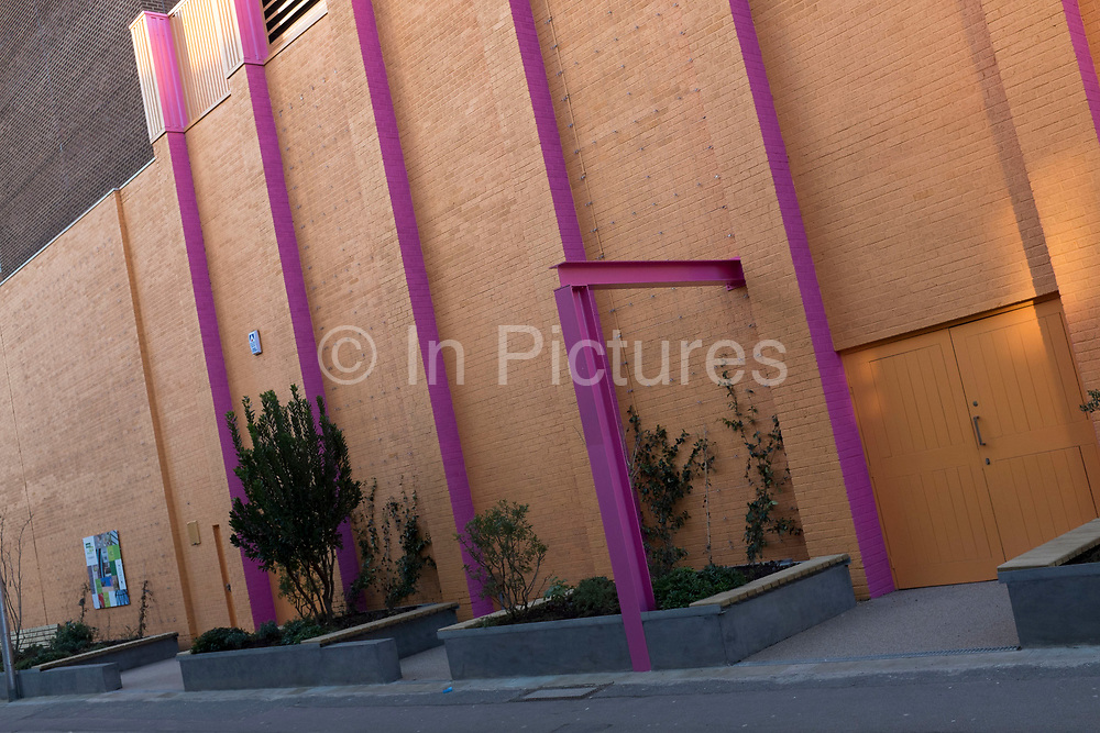 Modern brick wall with pink steel girders, part of the new development around Guy's Hospital in Southwark, London, UK.