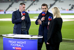 Sky Sports Pundit's Jamie Carragher (left) Gary Neville and Kelly Cates commentate on the match prior to the beginning of the Premier League match at London Stadium.
