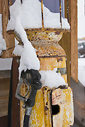 Vertical of old fuel pump covered with snow