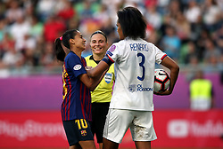 Barcelona Women's Andressa Alves attempts to get the ball back from Lyon Women's Wendie Renard