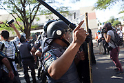 Police clash with several hundred protesters in Sao Paulo, Brazil, using tear gas and stun grenades on the opening day of the FIFA World Cup 2014. There were some arrests and injuries inlcuding a CNN producer. The protesters were dispearsed relatively quickly due to the Brazilian Police's early show of force.