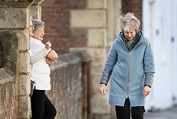 © Licensed to London News Pictures. 04/03/2019. Salisbury, UK. Local residents (L) greet Prime Minister Theresa May as she visits Salisbury on the first anniversary of the poisoning of former Russian spy Sergei Skripal and his daughter Yulia in March 2018. They both survived the nerve agent attack but a resident of nearby Amesbury, Dawn Sturgess, died in June 2018 after coming in contact with the poison. Two Russians have been named in connection with the attack. Photo credit: Peter Macdiarmid/LNP