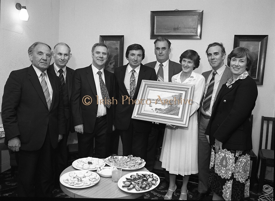 "The Carlingford Oyster Festival.1982.19.08.1982..08.19.1982.19th August 1982..Pictures and Images of the Carlingford Oyster Festival... The Minister For Fisheries and Forestry Mr Brendan Daly officially opened  The Carlingford Oyster Festival. The Chairman of the organising committee was Mr. Joe McKevitt..""The Oyster Pearl"" was Ms Deirdre McGrath..The committee present the Minister with a painting of Carlingford Lough."