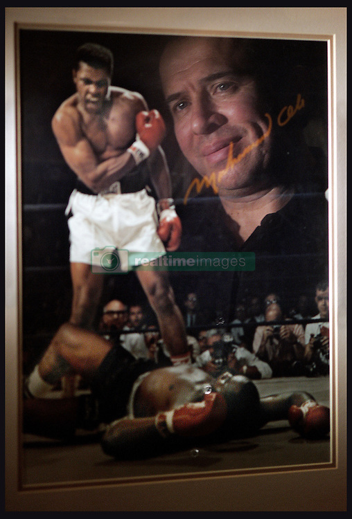 Dec 17, 2008 - Anaheim Hills, California, USA - Muhammad Ali was always Art Tinajero's hero, but after a chance meeting with the champ he became a 'life-long fan.' A kind stranger helped arrange an impromptu meeting with Ali who graciously invited the fan to lunch. A 1964 picture of Ali defeating Liston is prominently displayed in Tinajero's Anaheim Hillls home.    (Credit Image: © The Orange County Register/ZUMA Press)