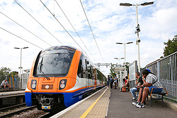 © Licensed to London News Pictures. 30/08/2019. London, UK. Passengers waiting at Harringay Green Lanes railway station as an electric train arrives travelling to Barking station in East London. <br /> London Overground's Gospel Oak to Barking line is exclusively operated by new four-car electric air-conditioned trains, doubling capacity, restoring a 15 minute frequency and bringing greater reliability to the service. To celebrate this milestone, the Mayor of London and Transport for London (TfL) are offering customers a month of free travel on the line from Saturday 31 August to Tuesday 1 October inclusive. The new state-of-the-art trains can carry nearly 700 people and feature free WiFi, real-time information screens, air-conditioning, USB charging points and more wheelchair spaces. Photo credit: Dinendra Haria/LNP