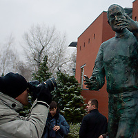 Photographer takes a photo of the first ever life-size bronze statue of late Apple leader Steve Jobs after the inauguration ceremony in Budapest, Hungary on December 21, 2011. ATTILA VOLGYI