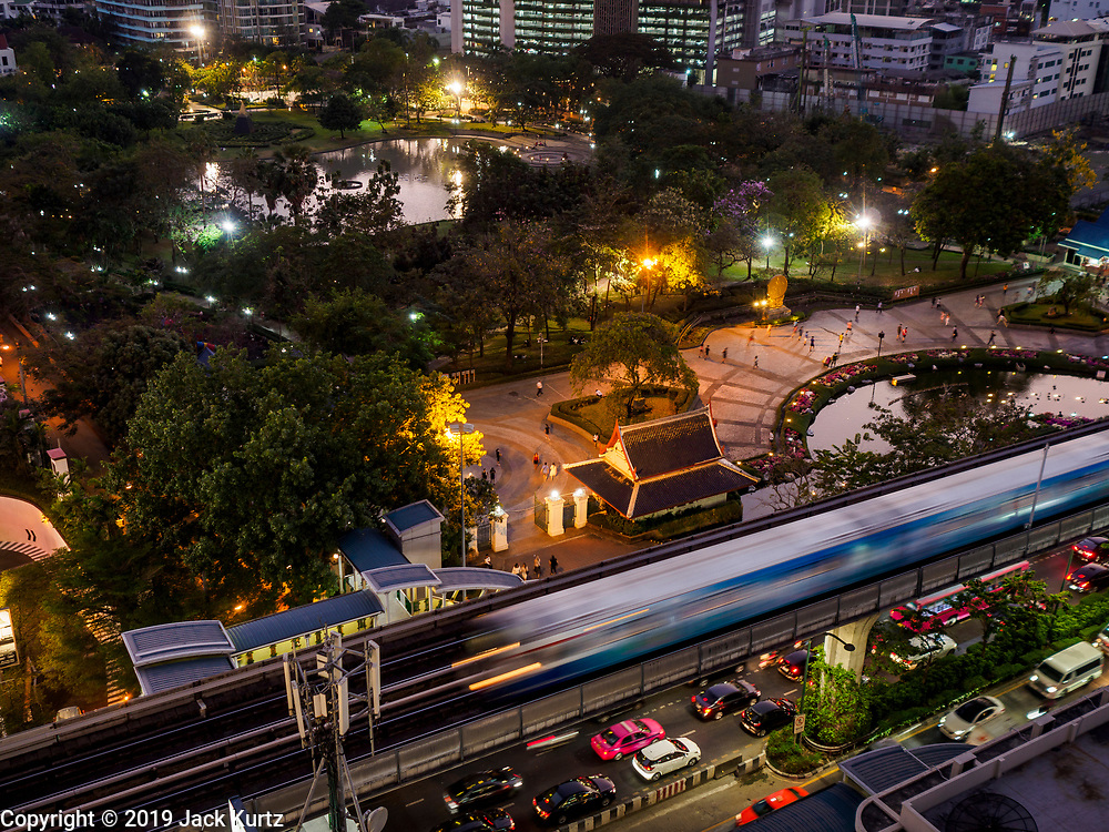 08 MARCH 2019 - BANGKOK, THAILAND: A BTS Skytrain goes out of Bangkok on the Sukhumvit Line at sunset.    PHOTO BY JACK KURTZ