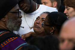 London, June 15th 2017. Local residents and well-wishers gather at a short vigil outside Notting Hill Methodist Church near the scene of the Grenfell Tower Fire Disaster in which so far seventeen people have been reported killed, with dozens injured, many still missing and scores of people rendered homeless. PICTURED: A woman is overcome with emotion - many local residents had friends and families  in Grenfell Tower.