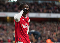 Football - 2019 / 2020 Premier League - Arsenal vs. Everton<br /> <br /> Eddie Nkietah (Arsenal FC) pretends to make a phone call as his celebration after scoring at The Emirates Stadium.<br /> <br /> COLORSPORT/DANIEL BEARHAM