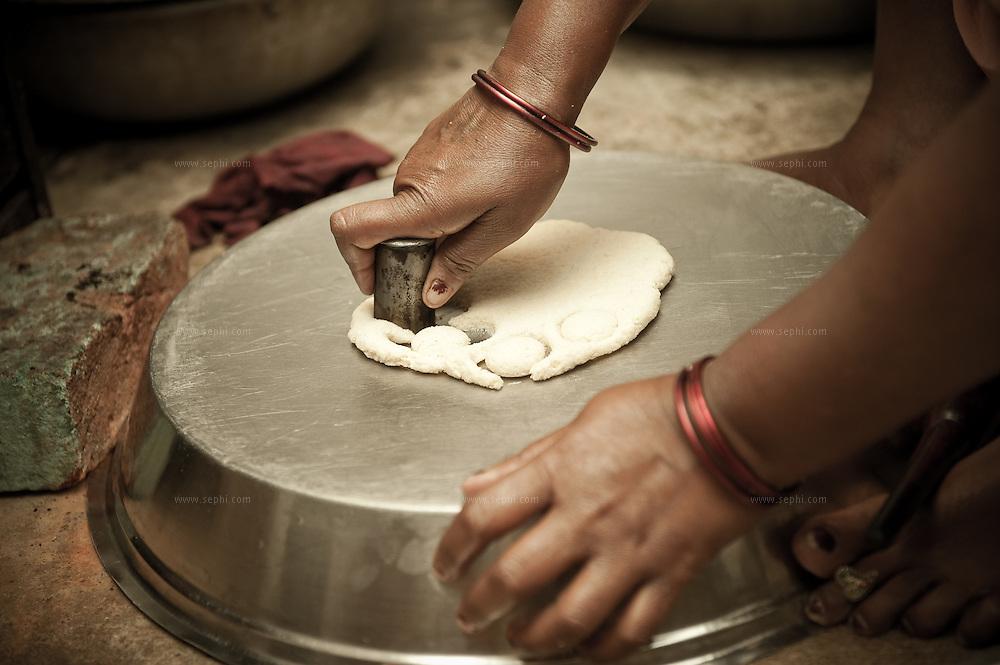 Devo Baghel preparing Gup-chup, a savory street food snack, that she sells every night on the streets of Raipur.