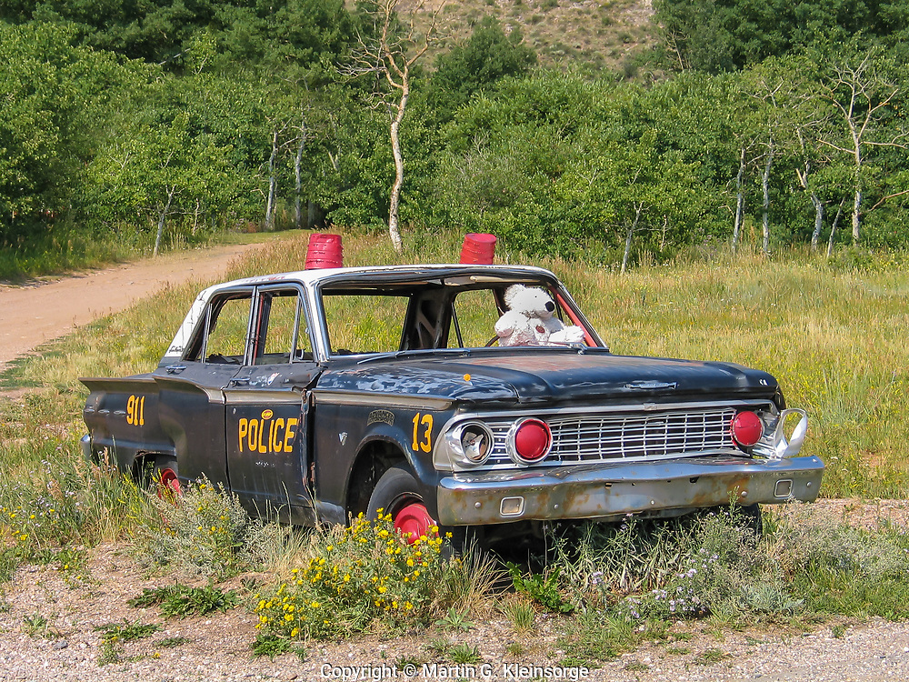 This old police car rests along HWY 130 in the center of Centennial, WY.