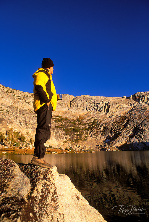 Climber enjoying the evening light from the shore of upper Young Lake, Tuolumne Meadows area, Yosemite National Park, California