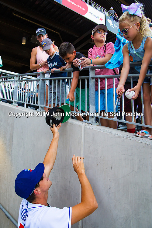 Amarillo Sod Poodles pitcher MacKenzie Gore (13) signs autographs before the game against the Springfield Cardinals on Wednesday, July 17, 2019, at HODGETOWN in Amarillo, Texas. [Photo by John Moore/Amarillo Sod Poodles]