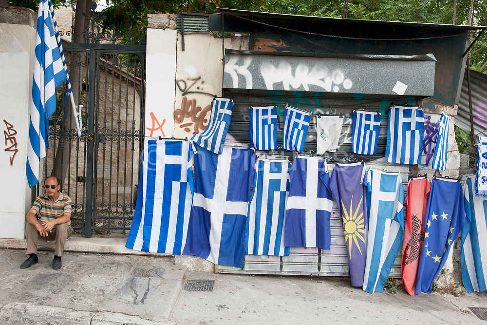 Street scene in Plaka, a man with Greek flags for sale. Plaka is the old historical neighborhood of Athens, clustered around the northern and eastern slopes of the Acropolis, and incorporating labyrinthine streets and neoclassical architecture. Plaka is built on top of the residential areas of the ancient town of Athens. It is known as the 'Neighbourhood of the Gods' due to its proximity to the Acropolis and its many archaeological sites. Athens is the capital and largest city of Greece. It dominates the Attica periphery and is one of the world's oldest cities, as its recorded history spans around 3,400 years. Classical Athens was a powerful city-state. A centre for the arts, learning and philosophy.