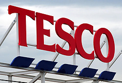 File photo dated 01/08/12 of a sign for a Tesco store, as the supermarket is to axe 1,200 jobs at its head office, the Press Association understands.