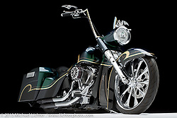 Paul Yaffe's Black and Green Bagger with S&S Super 124 Twin Tec Motor.  The bike has the Bagger Nation Softail Bagger Kit. Photographed in Sacramento, Ca at the Easyriders Bike Show in 2013.