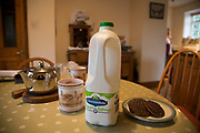 The end product on the farmhouse table. Cravendale milk for a cup of tea. Made by parent company Arla. Arla is a farmer owned international dairy and dairy products cooperative. Home to some of the UK's leading dairy brands, including Cravendale, Arla Foods UK supplies a full range of fresh dairy products to the major retailers and foodservice customers, from its 3000 cooperative farmers across the UK and further 9000 in Europe. Wildon Grange Dairy Farm, Coxwold, North Yorkshire, UK. Owned and run by the Banks family, dairy farming here is a scientific business, where nothing is left to chance. From the breeding, nutrition and health of their closed stock of Holstein Friesian cows, through to the end product, the team here work tirelessly, around to clock to ensure content and healthy animals, and excellent quality milk.