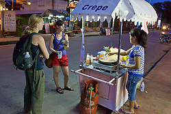 Tourists Buying Food From Vendor