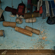 Rickshaw pullers belongings on the wall at the 'dera', the rickshaw garage..Of the nearly 18,000 pullers, about 75% dwell in 'deras', places where they park their vehicles during the night. These 'deras' belong to the 'sardars' who collect the hand-rickshaws on rental basis from the 'owners', and engage the pullers on different rates.