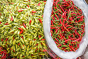 "03 OCTOBER 2012 - BANGKOK, THAILAND:   Chillies for sale in Khlong Toey Market in Bangkok. Khlong Toey (also called Khlong Toei) Market is one of the largest ""wet markets"" in Thailand. Thousands of people shop in the sprawling market for fresh fruits and vegetables as well meat, fish and poultry every day.     PHOTO BY JACK KURTZ"