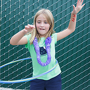 Hadley Miller,6, hula hoops Thursday August 7, 2014 during The Shrip-A-Roo at Buddy's Crab House & Oyster Bar in Wrightsville Beach, N.C.  (Jason A. Frizzelle)