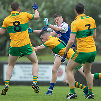 St. Senan's Kilkee's Conor Deloughery is blocked by O'Curry's Cathal Downes