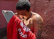 "A migrant examines wounds in his face in a mirror in the migrants shelter ""San Juan Diego Cuauhtlatoatzin"" Lechería, Estado de México, on september 28th, 2011. (Photo: Prometeo Lucero)"