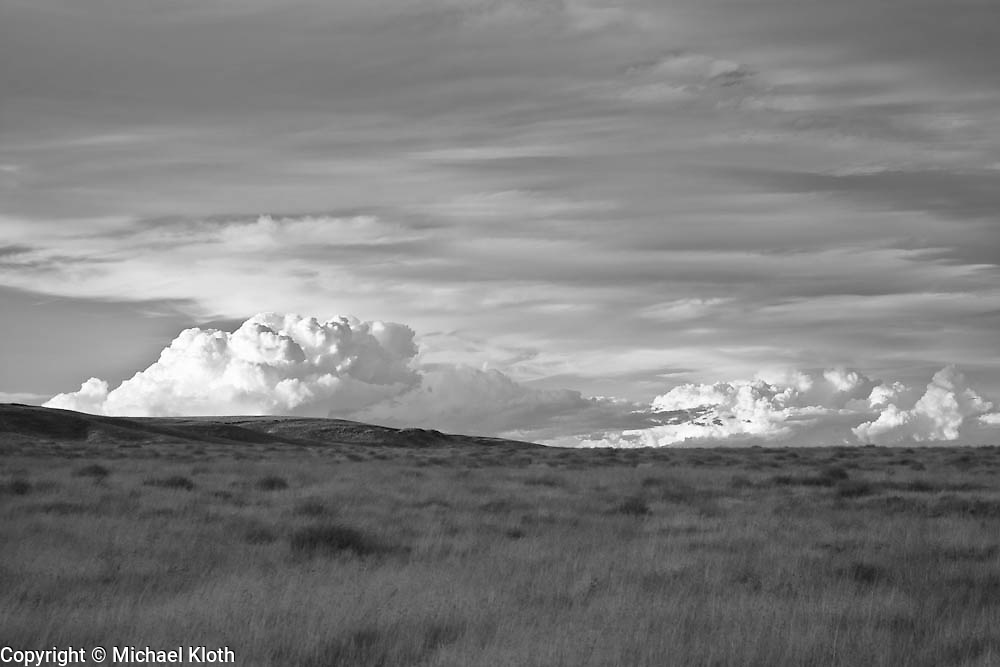 Rattlesnake Slope Wildlife Area.  Infrared (IR) photograph of desert scene with large cloud.  Landscape photography by Michael Kloth.