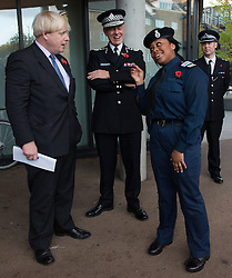 © Licensed to London News Pictures.30/10/2013. London, UK. The Mayor of London Boris Johnson (L) and Sir Bernard Hogan-Howe, Commissioner of Police of the Metropolis (C) visit the Southwark's volunteer police cadets at Walworth Academy.Photo credit : Peter Kollanyi/LNP
