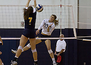 Senior Janae Vander Ploeg, Outside Hitter, spikes the ball pass Northern Colorado's Ashley Guthrie (Jr.) for a point during the second set of th NAU vs. UNC volleyball game, Oct. 24, 2015. Ploeg would end up having 21 kills during the game. (Photo by David Carballido-Jeans)