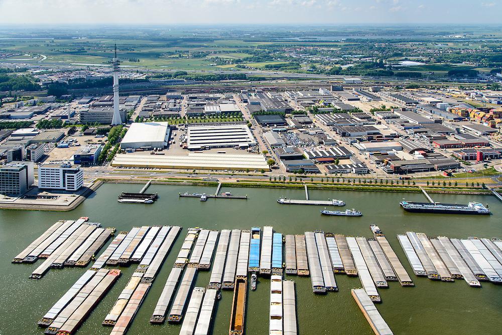 Nederland, Zuid-Holland, Rotterdam, 10-06-2015;<br /> Waalhaven Zuidzijde met duwbakken en lichter voor anker. In de achtergond KPN-zendmast Waalhaven en bedrijventerrein Waalhaven-Zuid . Het landelijk gebied ten oosten van Rhoon en Portugaal in de achtergrond.<br /> Waalhaven Zuid business park.<br /> <br /> luchtfoto (toeslag op standard tarieven);<br /> aerial photo (additional fee required);<br /> copyright foto/photo Siebe Swart