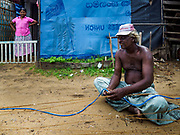 07 OCTOBER 2017 - MORATUWA, SRI LANKA: Fishermen repair their nets while they chat in Moratuwa, a fishing village south of Colombo. Fish is an important source for many Sri Lankans.  PHOTO BY JACK KURTZ