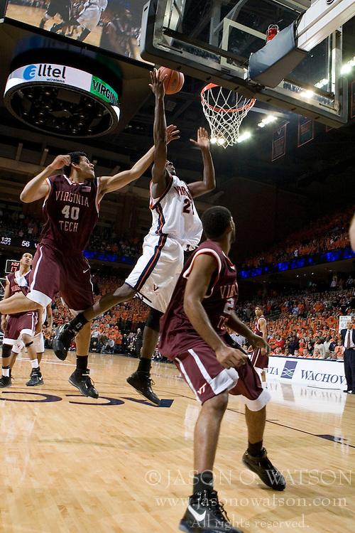Virginia Cavaliers center Tunji Soroye (21) shoots over Virginia Tech Hokies forward A.D. Vasallo (40).  The Virginia Cavaliers Men's Basketball Team defeated the Virginia Tech Hokies 69-56 at the John Paul Jones Arena in Charlottesville, VA on March 1, 2007.