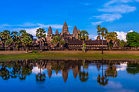 View of Angkor Wat with pond. It is the largest religious monument in the world. It's name means City which is a  temple; Cambodia.