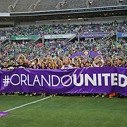 ORLANDO, FL - SEPTEMBER 13:  Orlando elected officials, business leaders, public safety officials, hospital staff and friends of the Pulse nightclub shooting victims sing the National Anthem during a MLS soccer match between Sporting Kansas City and the Orlando City SC at the Orlando Citrus Bowl on September 13, 2015 in Orlando, Florida. (Photo by Alex Menendez/Getty Images) *** Local Caption ***