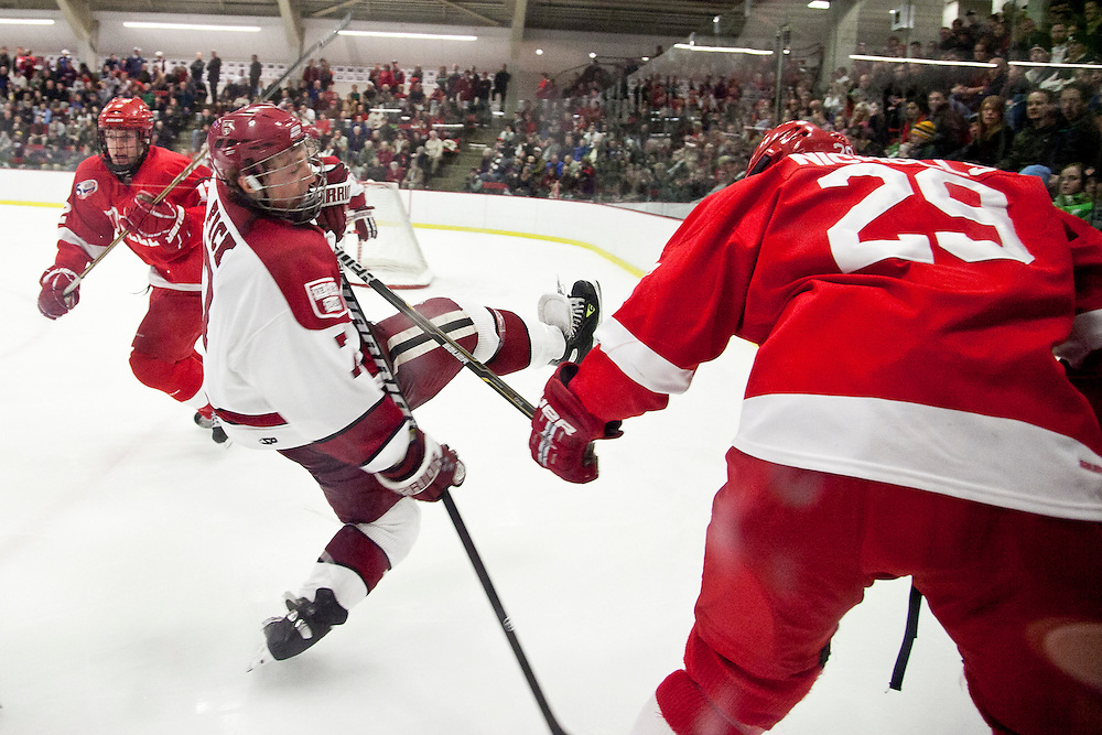 Cornell University defenseman, Dan Nicholls (29) hits Harvard University forward, Danny Fick during third period action at Harvard University.