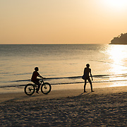 Cyclist Sihouette On Langkawi Cenang Beach, Malaysia