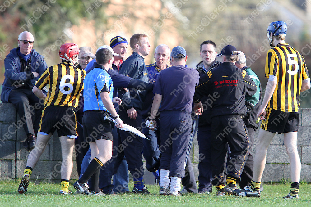 """Tempers flare on the sideline as """"Socks"""" McInerney & Fergie O'Loughlin don't see eye to eye during the Minor """"A"""" Final at Clarecastle. - Photograph by Flann Howard"""