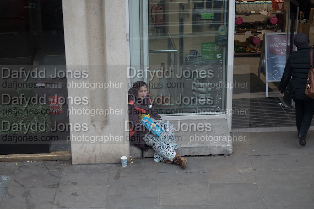 Begging Outside Waitrose, Kensington High St. Homeless, begging,  The Strand, London. 28 January 2016