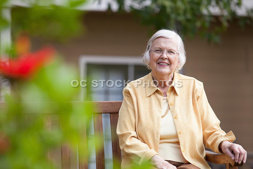 Senior Woman Sitting on a Bench Enjoying the Outdoors