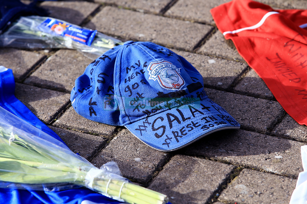 A view of a hat with written messages in tribute to Emiliano Sala during the Premier League match at the Cardiff City Stadium.