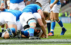 England's Jamie George (bottom) scores his side's first try during the Guinness Six Nations match at Twickenham Stadium, London.