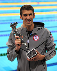 USA's Michael Phelps holds a trophy for being the Greatest Olympic Athlete of All Time after the Men's 4x100m Medley relay at the Aquatic Centre, Olympic Park, during day eight of the London 2012 Olympics.