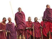 Maasai tribesmen in traditional dance called Adumu, a jumping competition. Tipilit village near Amboseli National Park, Kenya