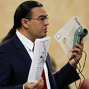 During his closing statements to the jury, O. Rene Flores holds a slide viewer that was found in a canal near Irene Garza's body in 1960. An advertisement was placed by law enforcement for information on the viewer, which Feit claimed ownership. Flores argued that Feit would not have admitted to owning the viewer if he had committed Garza's murder. Nathan Lambrecht/The Monitor