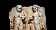 Close up of a Roman Sebasteion relief  sculpture of  Two princes, Aphrodisias Museum, Aphrodisias, Turkey.  Against a black background.<br /> <br /> Two princes stand like statues, naked, wearing cloaks. The left figure holds the orb of the world in one hand, a symbol of  world rule that indicates he is the imperial heir, and in the other a ship's stern ornament (aphlaston), a symbol of naval victory. They and probably Gius and Lucius, the grandsons of Augustus, or Nero and Britanicus, Claudius' heir. .<br /> <br /> If you prefer to buy from our ALAMY STOCK LIBRARY page at https://www.alamy.com/portfolio/paul-williams-funkystock/greco-roman-sculptures.html . Type -    Aphrodisias     - into LOWER SEARCH WITHIN GALLERY box - Refine search by adding a subject, place, background colour, museum etc.<br /> <br /> Visit our ROMAN WORLD PHOTO COLLECTIONS for more photos to download or buy as wall art prints https://funkystock.photoshelter.com/gallery-collection/The-Romans-Art-Artefacts-Antiquities-Historic-Sites-Pictures-Images/C0000r2uLJJo9_s0