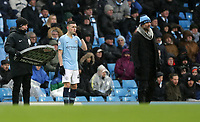 Football - 2018 / 2019 Premier League - Manchester City vs. Everton<br /> <br /> Phil Foden of Manchester City waits with Manchester City Manager Josep Guardiola but ends up not getting on the pitch at The Etihad.<br /> <br /> COLORSPORT/LYNNE CAMERON