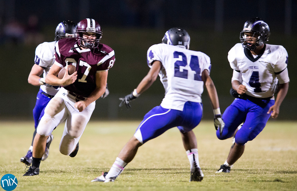 Jay M. Robinson's Harrison Schmitt looks for room to run against Cox Mill Friday night at Jay M. Robinson High School n Concord. (Photo by James Nix)