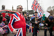 Pro Brexit Leave supporter with a Union Jack suite sings anti-EU songs as people gather in Westminster on Brexit Day as the UK prepares to leave the European Union on 31st January 2020 in London, England, United Kingdom. At 11pm on Friday 31st January 2020, The UK and N. Ireland will officially leave the EU and go into a state of negotiations as to the future arrangement and trade agreement, while adhering to EU rules until the end of 2020.