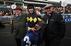 Tom O'Brien celebrates his victory in the Coral Welsh Grand National Handicap Chase with owner John Romans (left) and trainer Colin Tizzard (right) during the Coral Welsh Grand National day at Chepstow Racecourse.